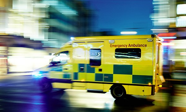 Picture shows an ambulance travelling at high speed in an urban scene. Ambulance crews are to be allowed to see patients' mental health crisis plans to help cut emergency admissions