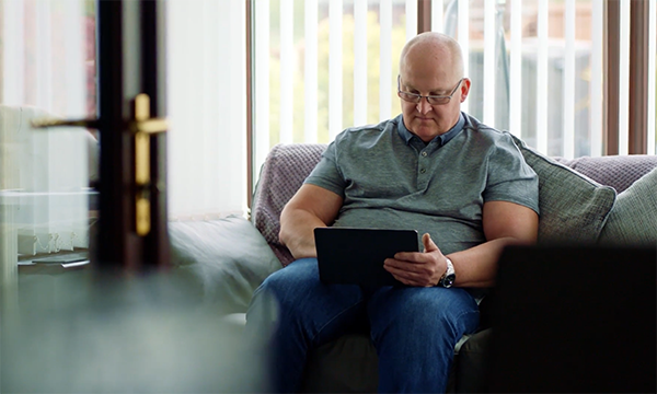 Picture shows an older man checking the results of his PSA test online as part of the supported self-management programme. New care pathways are easing the strain on prostate cancer services and could be applicable to other types of cancer.