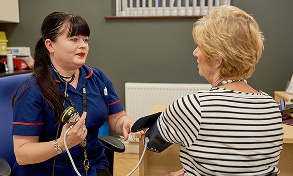 Picture shows a practice nurse with a female patient. Doncaster's scheme to attract and keep practice nurses is part of a growing trend across the country.