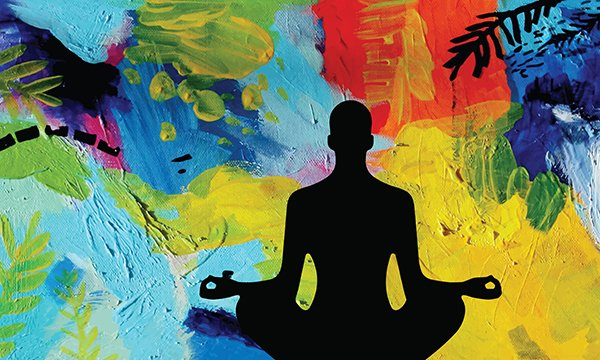 Image shows silhouette of a male meditating in lotus position against abstract background.Wellness events such as games or creative activitiesease strains and help prevent burnout.