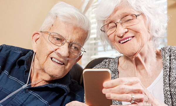 Two older people going through a video consultation on a smart phone. Consultations can now take place via video call over the internet. Picture: iStock