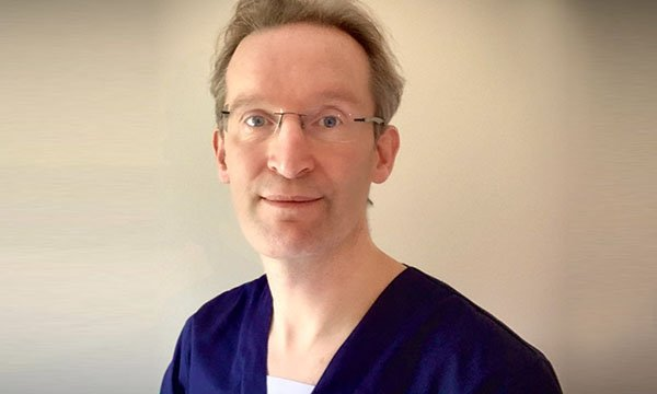 Consultant thoracic surgeon Joel Dunning is now working shifts as an ICU nurse